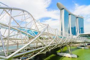 Helix bridge with Marina Bay building in Singapore photo