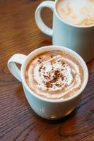Hot cocoa and chocolate in white cup or mug photo
