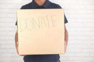 Man holding a donation box