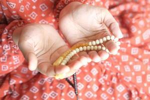 Women holding prayer beads photo