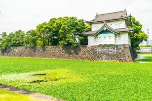 Imperial palace castle with moat and bridge in Tokyo city, Japan photo