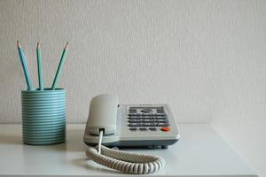 Old home phone on a table photo