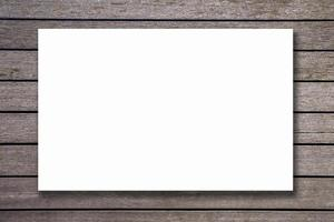 Blank paper texture on vintage brown wood background photo