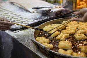 Hand is cooking Phongko, food is famous in the Asian countries photo