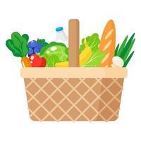 Ilustración de dibujos animados de vector de cesta de picnic de mimbre con alimentos orgánicos saludables aislado sobre fondo blanco