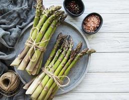 Bunch of raw asparagus stems photo