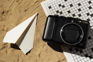 Flat lay camera and paper plane photo