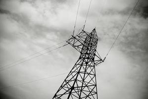 A pylon in black and white. High voltage line. photo