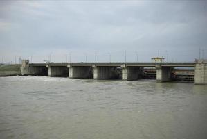 A dam built in the Soviet era. Concrete dam on the river. photo