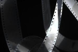 Black abstract background with 35mm photographic film photo