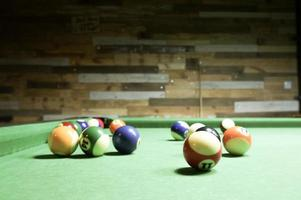 Billiard balls on a green table. photo