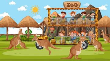 Safari at day time scene with many kids watching kangaroo group vector