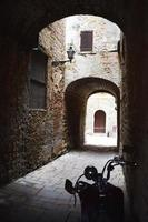 Motorbike in a narrow alley photo
