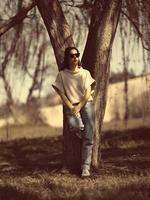 Fashion woman outdoor in spring scenery photo