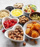 Bowls with various dried fruits and nuts photo