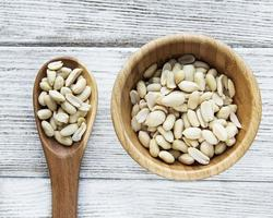 Peeled peanuts in a wooden bowl photo
