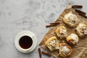 Flat lay cinnamon rolls and coffee photo