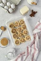 Flat lay cinnamon rolls and ingredients photo