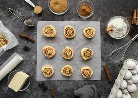 Flat lay cinnamon rolls and spices photo