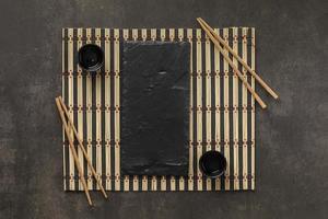 Elegant table setting with chop sticks photo