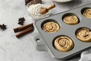 Tray with cinnamon rolls high angle photo