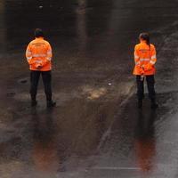 Spain, Apr 2019 - Two civil protection agents in orange vests photo