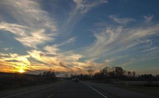 Sunset over a road photo