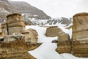 Winter clings to the hoodoos as spring arrives in The Badlands photo