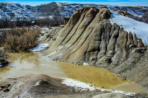 Snow on The Badlands mountains photo