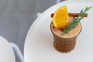 Iced coffee mix with orange juice toping orange sliced. photo