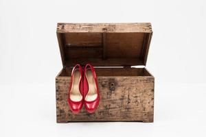 Red shoes with box on a white background photo