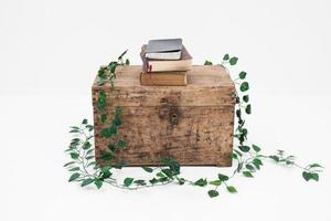 Books on a wooden box with white background photo