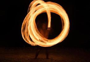 Fire show on the beach photo