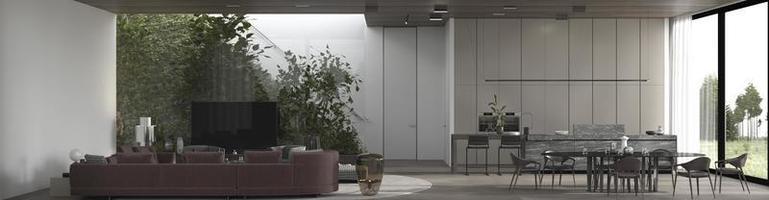 Vista de una sala de estar y una cocina de planta abierta. foto