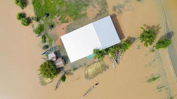 Aerial top view of flooded rice paddies and the village photo