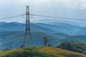 High voltage power lines on the mountain photo