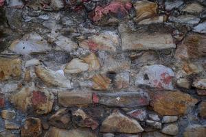 Worn stone wall photo