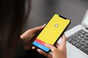 Chiangmai, Thailand, Apr, 06, 2021 - Person using the Snapchat app photo