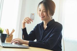 Woman paying online photo
