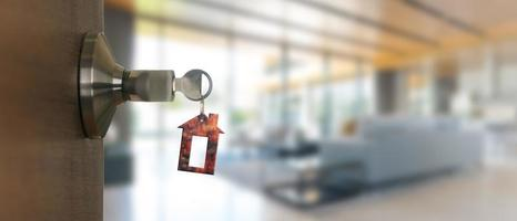 Open door at home with key in keyhole, new housing concept photo