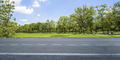 Empty highway asphalt road and beautiful sky in landscape green park photo