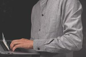 Man on laptop shows a hologram stock photo