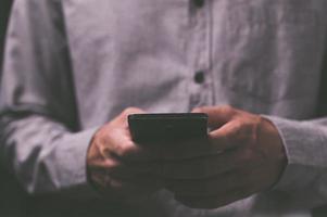 People using smartphones with dark tones photo