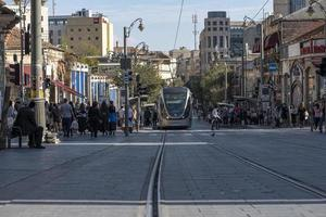 Jerusalem, Israel 2020- Tramway in the city center with pedestrians on the street photo