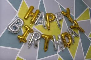 Golden HAPPY BIRTHDAY words made of inflatable balloons photo