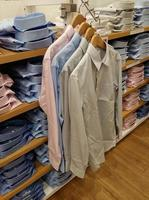 Mens shirt hanging in a clothing store photo