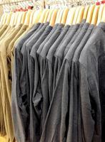 Long sleeved shirts hanging for sale photo