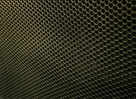 textura hexagonal de hierro dorado foto