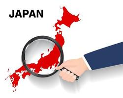 hand use magnifying glass searching on japan map vector