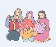 Holiday, gift, celebration concept. Happy young sisters spent time at home.Girls with christmas gift. sisters together. vector